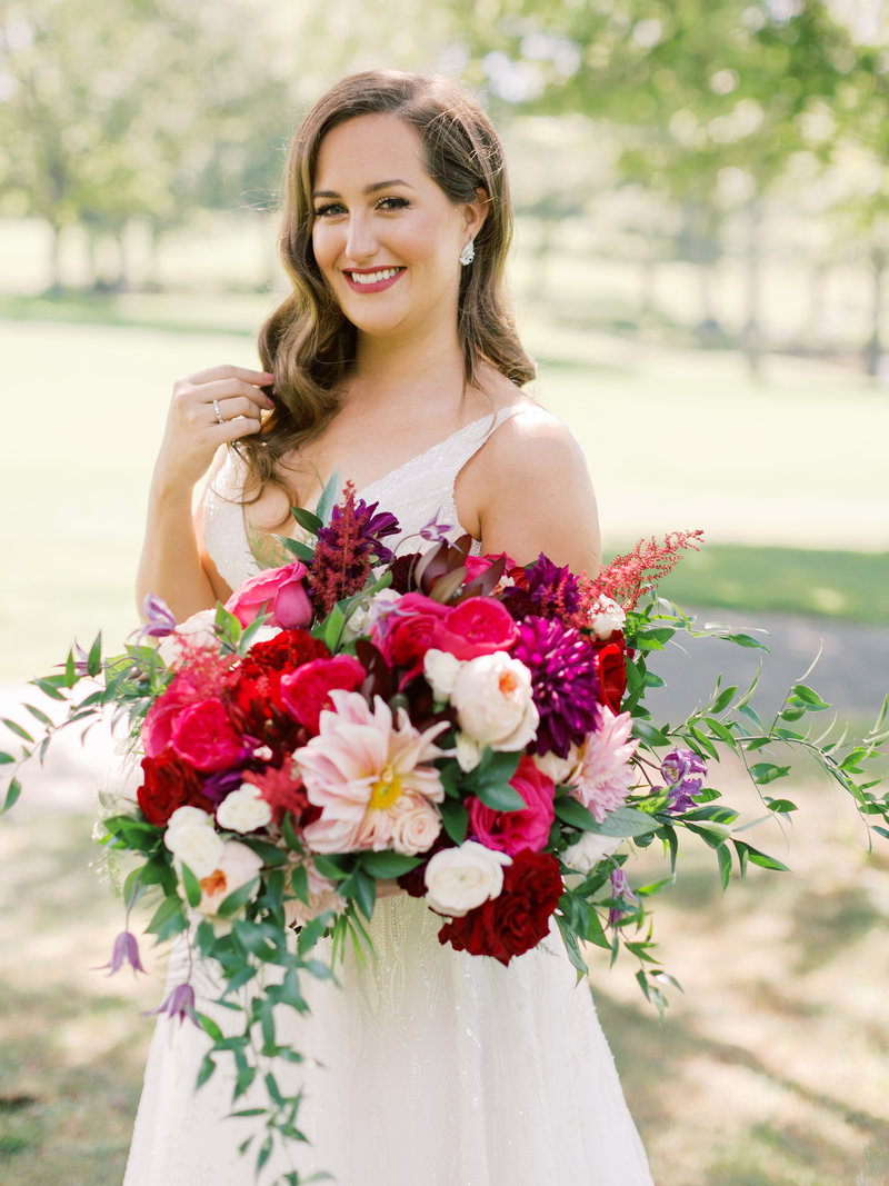 Bridal bouquet with jewel toned flowers and dahlias