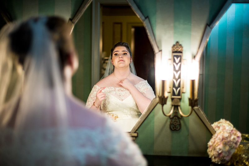 Bride getting ready at the Warner Theatre in Erie, PA