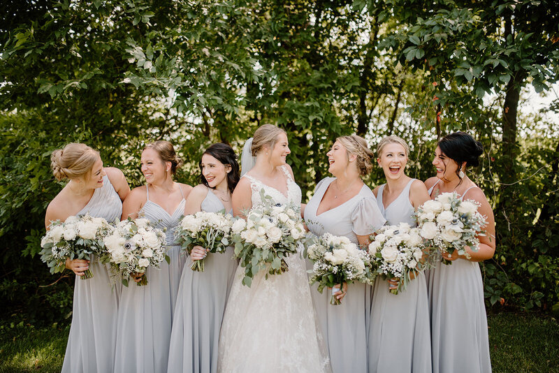 Bridesmaids looking at each other and laughing