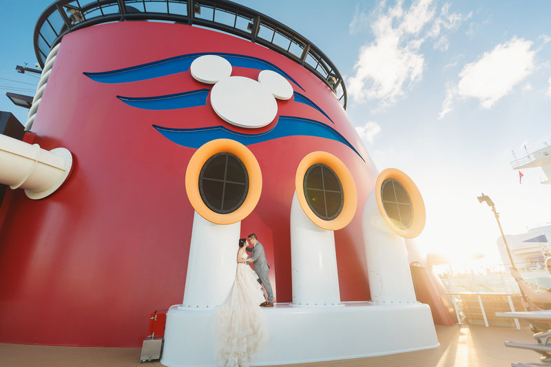 Bride and Groom Embrace on the Deck of a Disney Cruise Ship During their Wedding Cruise Photo Shoot