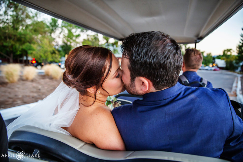 Kissing on a Golf Cart The Barn at Raccoon Creek in Littleton Colorado