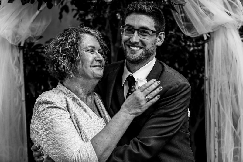Groom hugging his mom at Sheraton Erie Bayfront Hotel