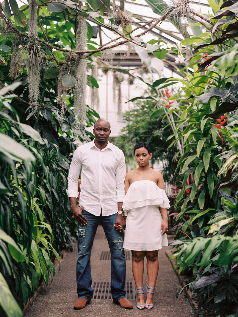 Modern greenhouse engagement session on film