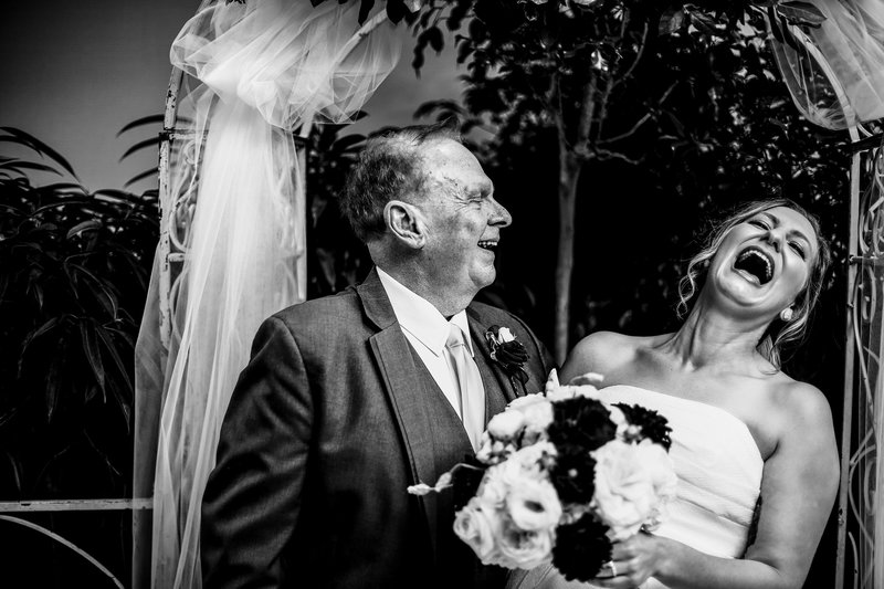 Bride laughing with her father at Sheraton Erie Bayfront Hotel