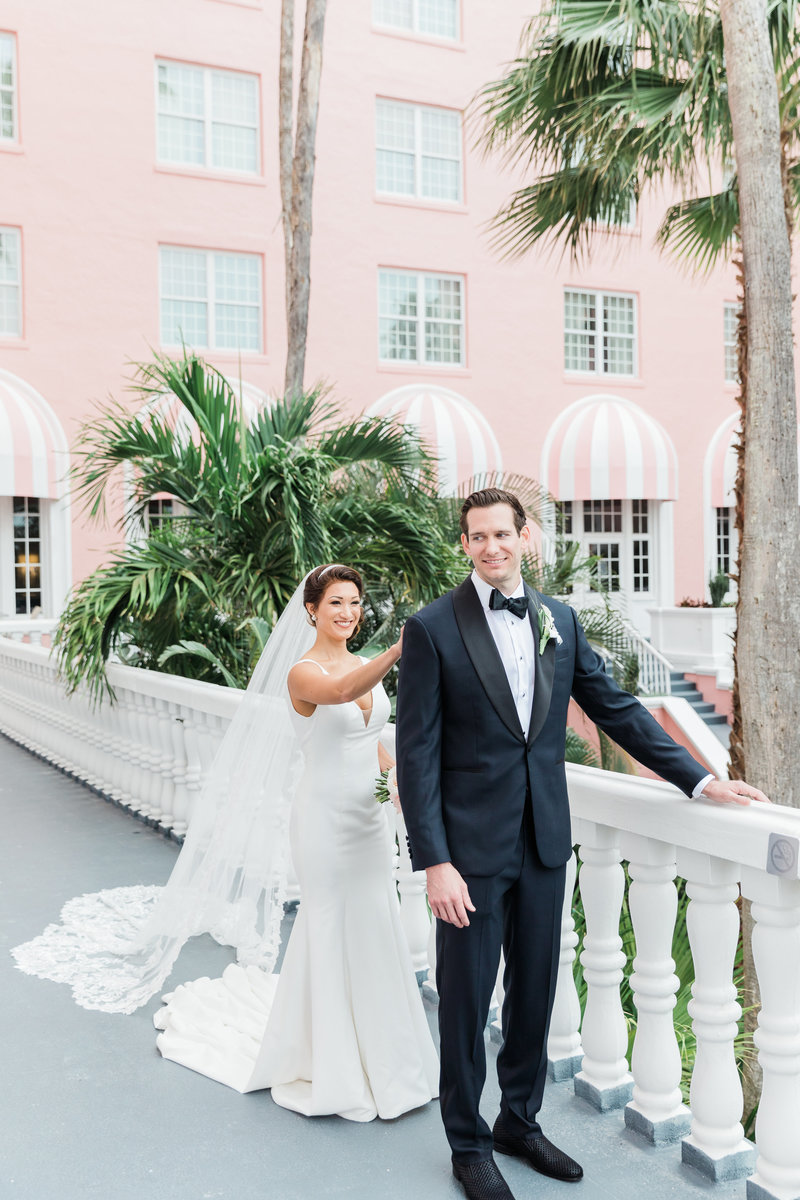 bride tapping groom on shoulder during first look at Don Cesar Wedding Photographer in St. Petersburgh Florida by Costola Photography