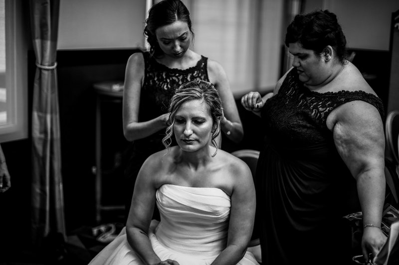 Bridesmaids fixing bride's hair before wedding at the Sheraton Erie Bayfront Hotel