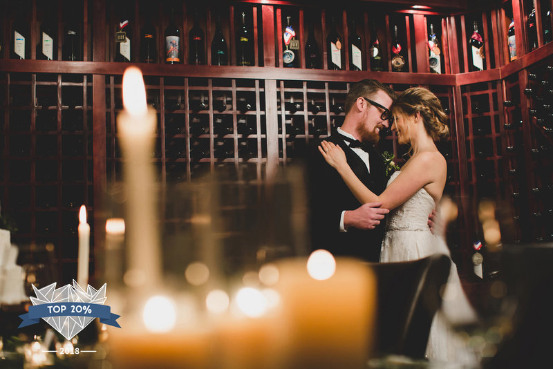 Bride and Groom hugging in Airfield states wine library in candle light