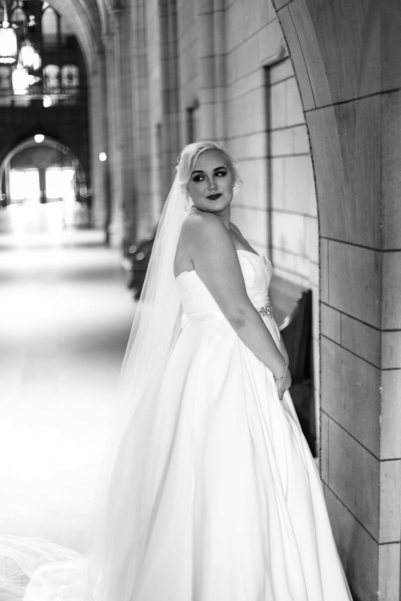 Full length solo portrait of bride inside the Cathedral of Learning in Pittsburgh, PA