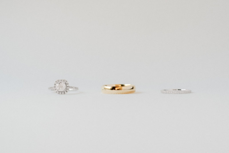 Bright and classic film inspired wedding rings detail photo