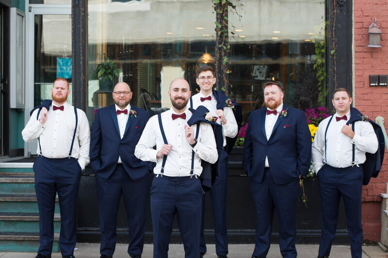groomsmen in navy suits at cityflats downtown port huron