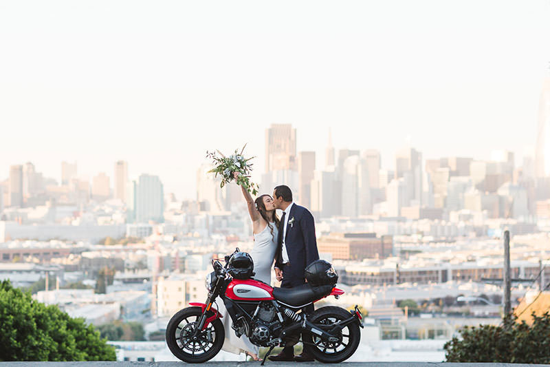 bride and groom posing with motorcycle in Potrero Hill, San Francisco