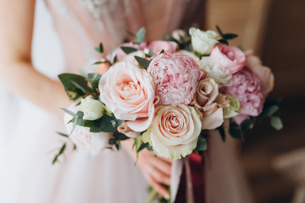 brides-wedding-bouquet-with-peonies-freesia-other-flowers-women-s-hands-light-lilac-spring-color-morning-room_91924-139