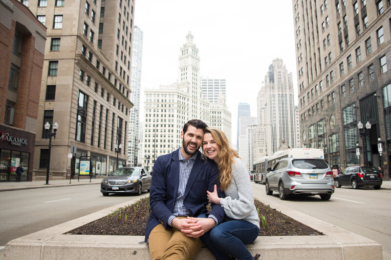couple on michigan avenue hugging  after surprise proposal in downtown chicago