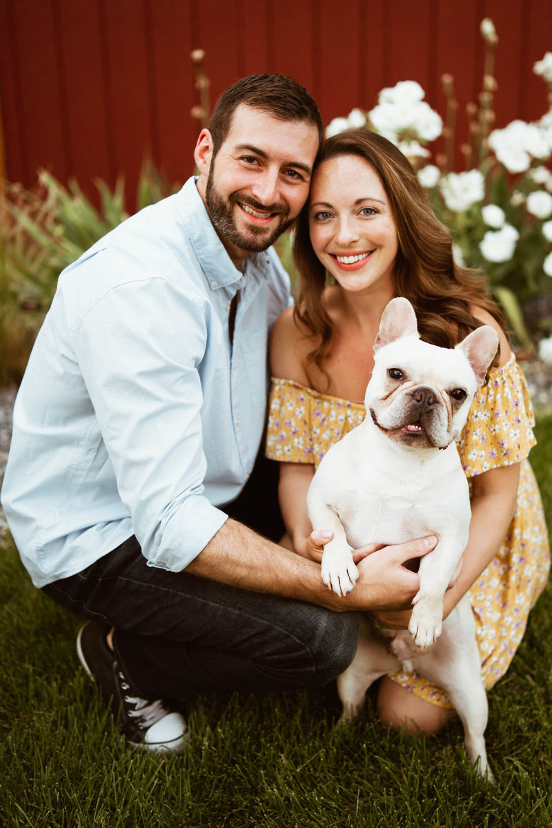 couple and dog pose for engagement photo
