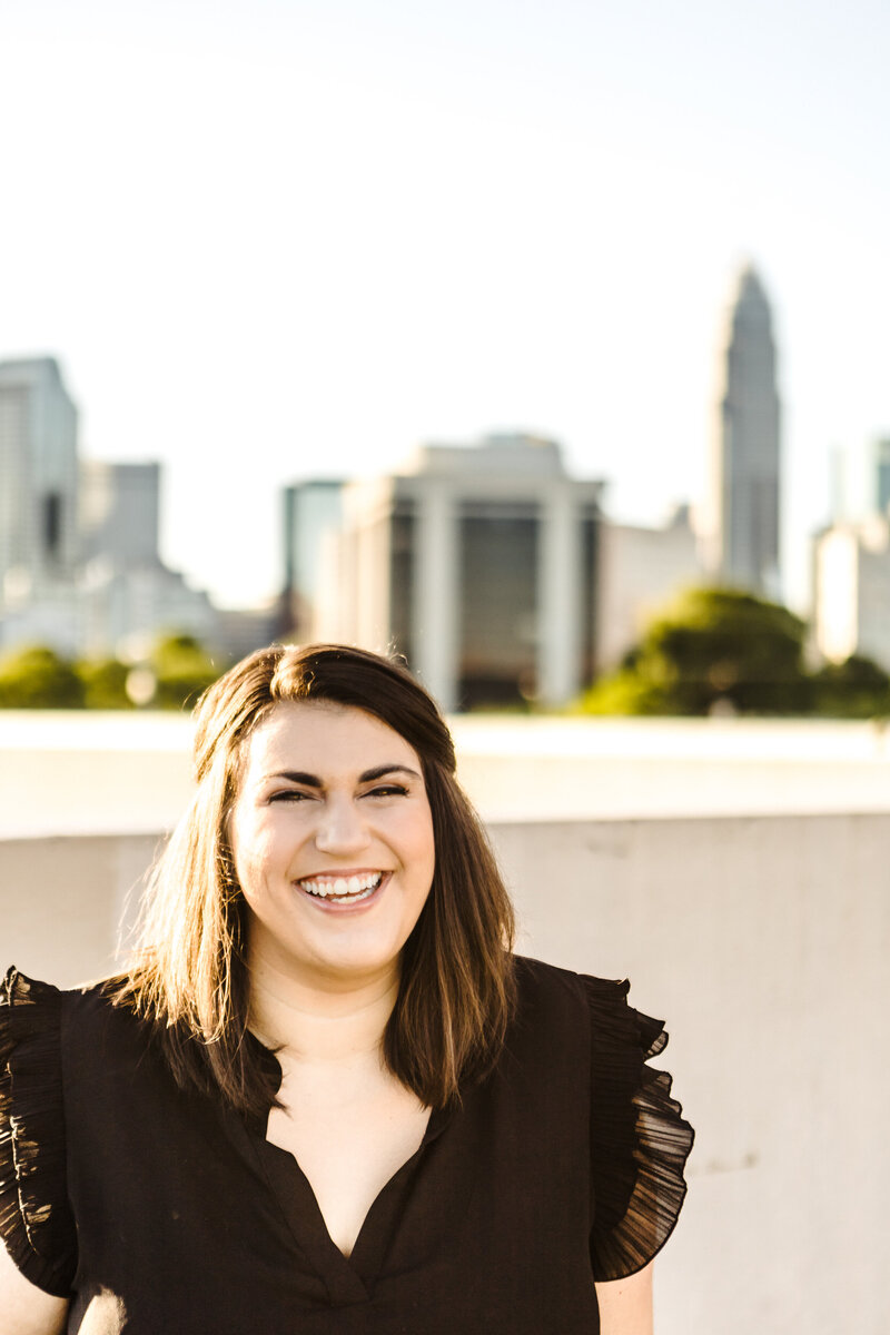 charlotte wedding photographer in front of uptown skyline