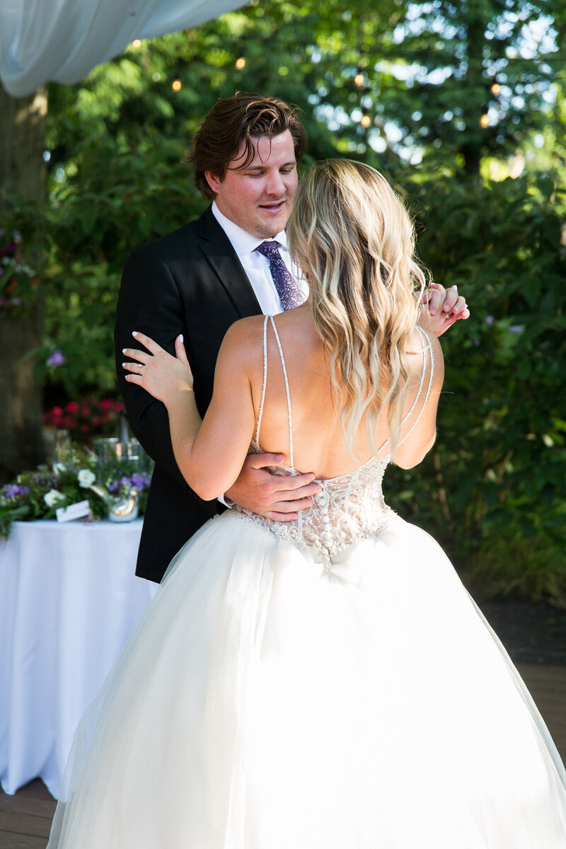 bride and groom first dance in cleveland covid backyard wedding