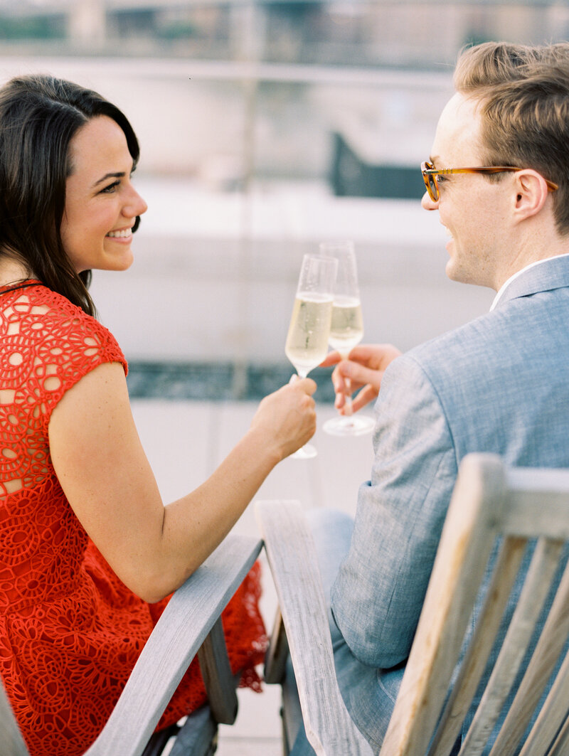 Rooftop new york city engagement session with champagne