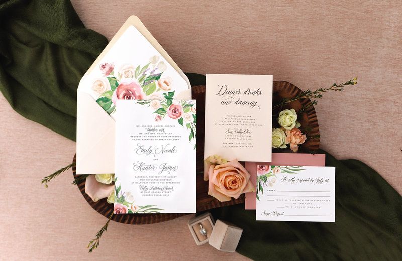 An elegant floral wedding invitation featuring hand-painted watercolor roses, lavender and beautiful flowing greenery.