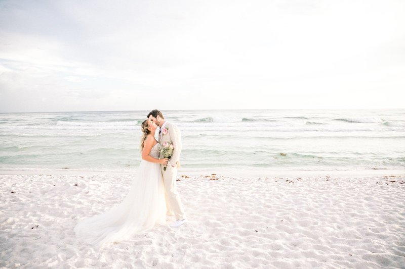 Charleston beach wedding photograph of bride and groom by Edwards Photography
