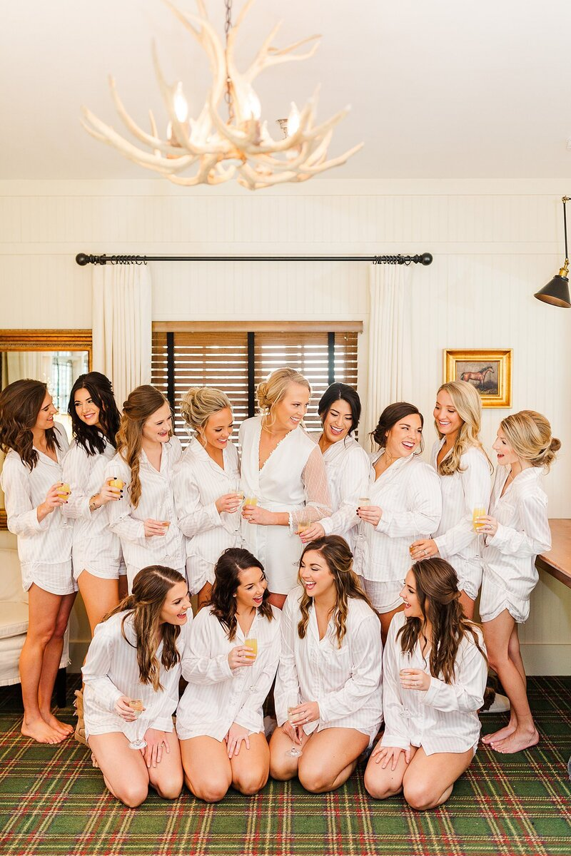 bridal party in matching robes by Knoxville Wedding Photographer, Amanda May Photos