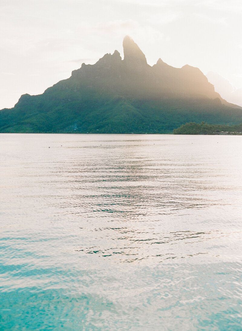 Mount otemanu and blue water at sunset in Bora Bora landscape view