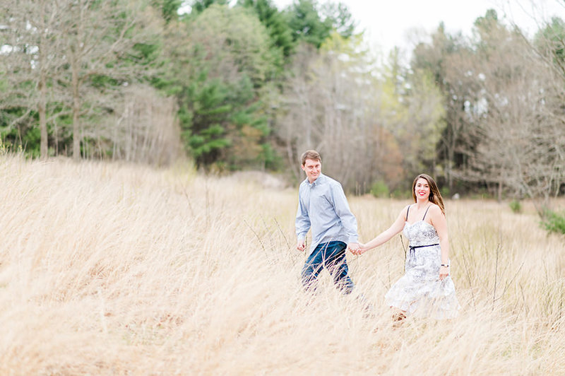 engagement photo in grass field
