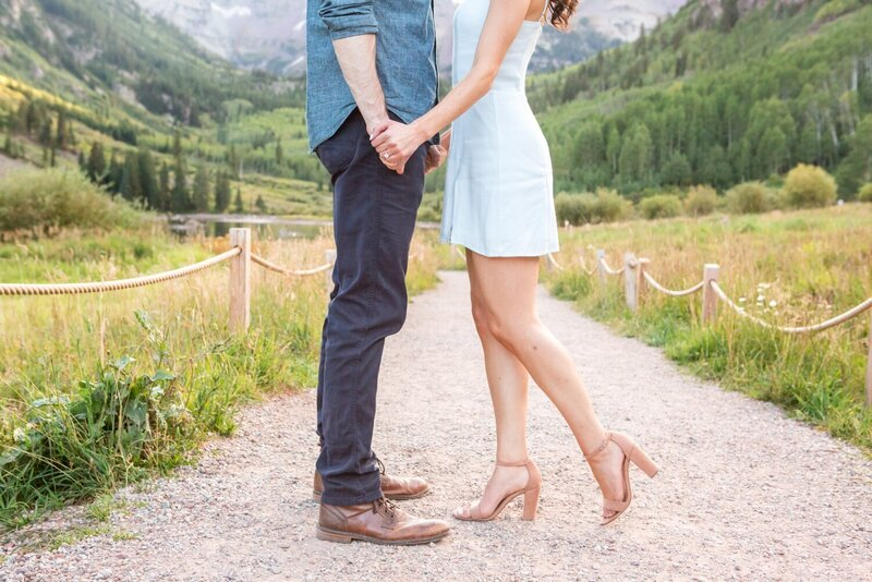 Proposal photos in Colorado ring and holding hands