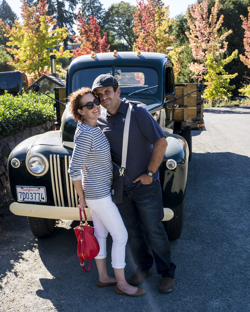 Matt & Teri Mead (of Matt Mead Photography) pose in front of old style truck at winery in Napa Valley, CA