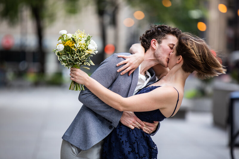 bride and groom kissing in downtown Chicago