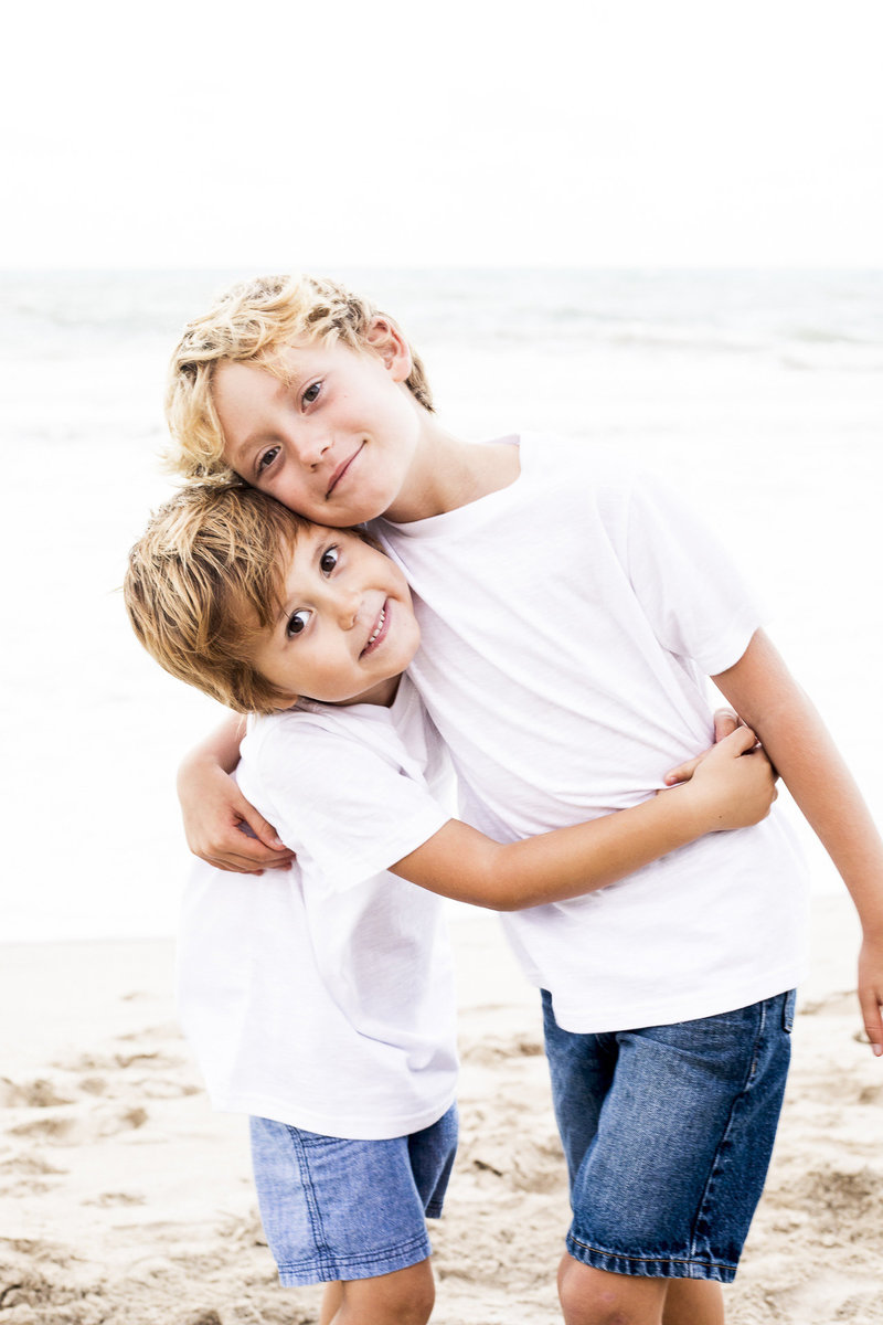 Two brothers photographed on Kailua Beach by Sharon Holck Photography