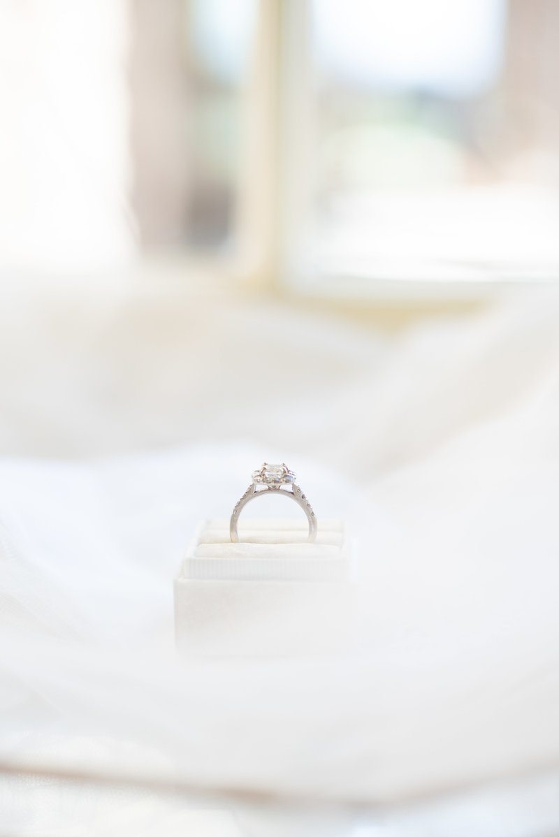 Bright and airy photo of ring  in ring box