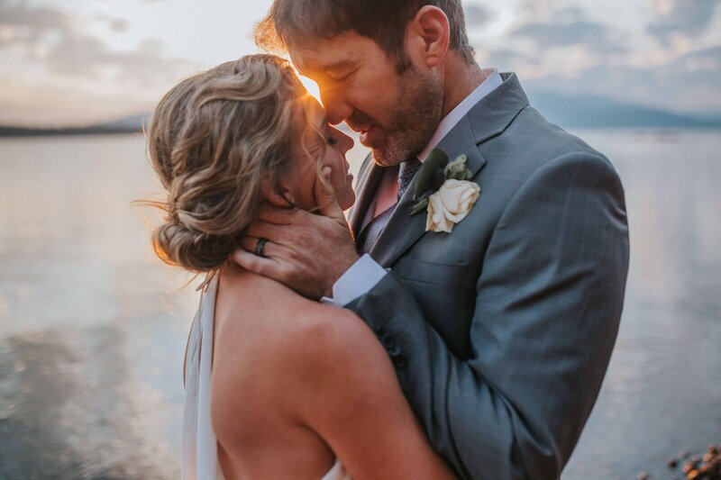 groom-clutches-brides-face-during-sunset-ceremony-n knoxville tennsesee wedding video