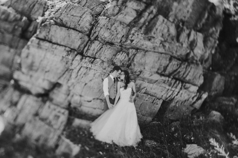 MT National Park Elopement Couple Embracing at Cliff