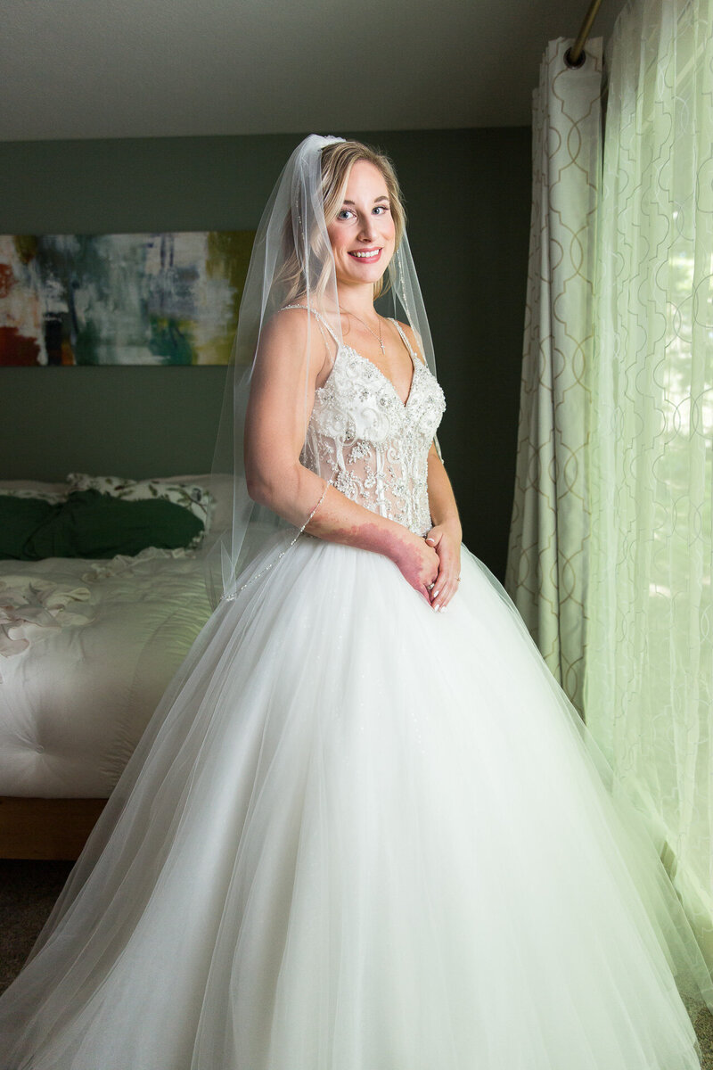 bride portrait smiling in wedding dress