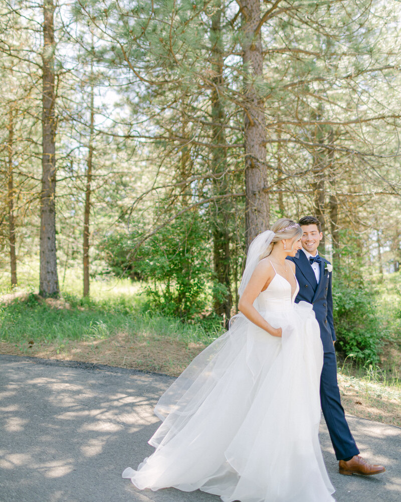 bride and groom holding hands and walking away at Swiftwater Cellars in Suncadia