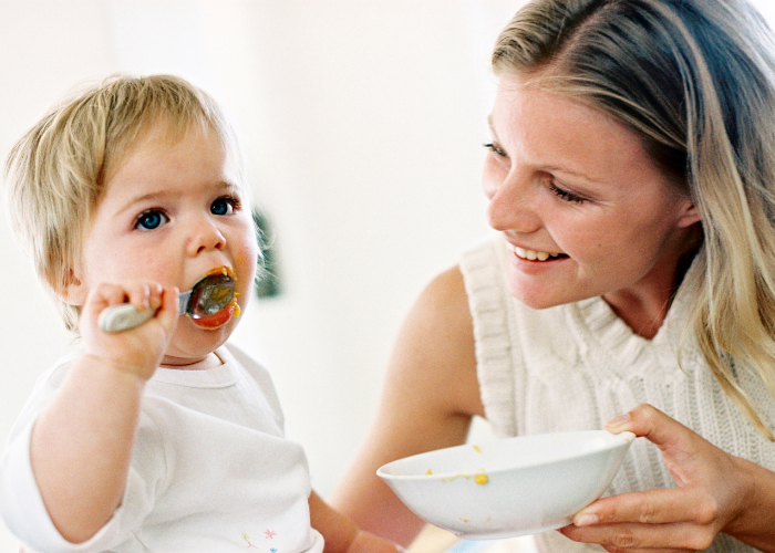 Thrive by Spectrum Pediatrics image for thrive today is a child happily eating with mother during mealtime