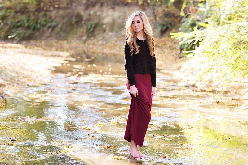 High School Senior Standing in a creek at Davis Park in Dallas, Texas