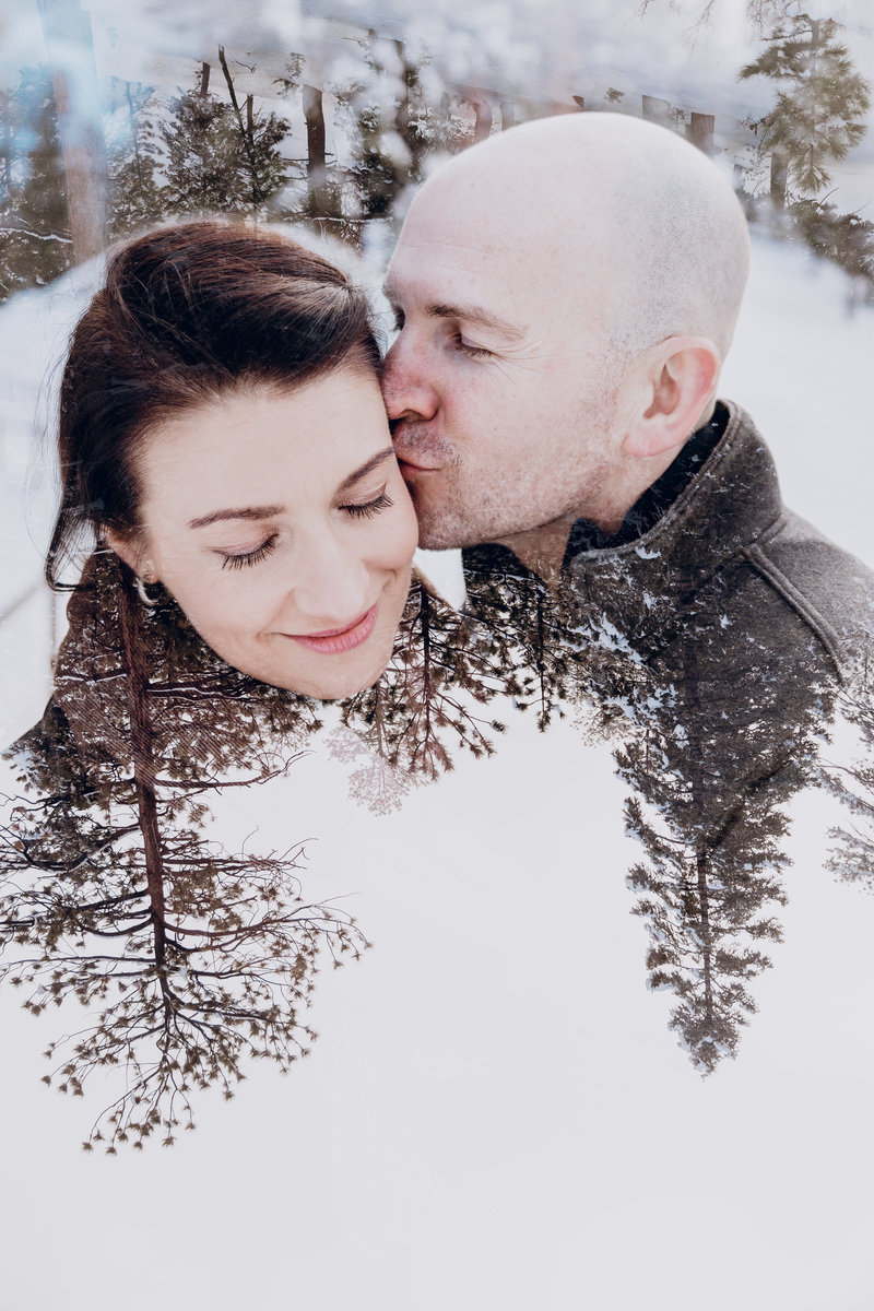 tahoe engagement pictures double-exposure of couple in snowy woods