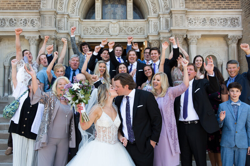 families and bridal party celebrate exit photo wedding at st. john cantius church