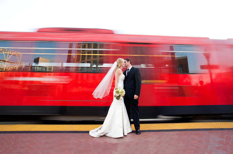 Downtown San Diego wedding photos urban trolley shot