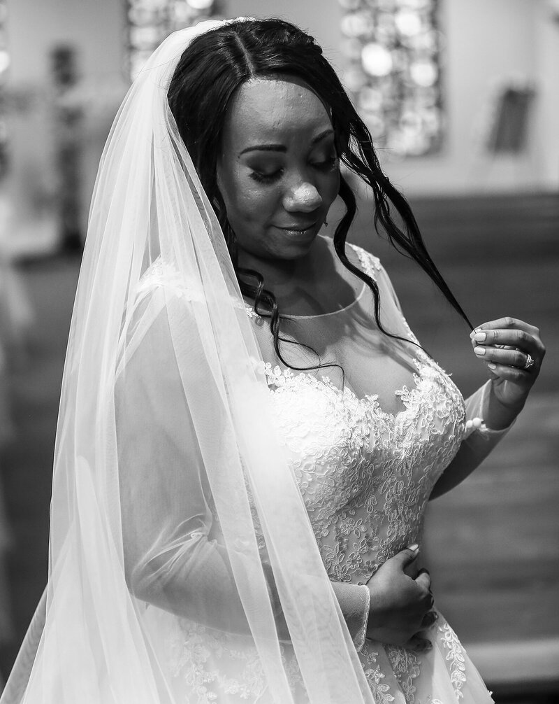 Solo portrait of bride in the church before her wedding ceremony