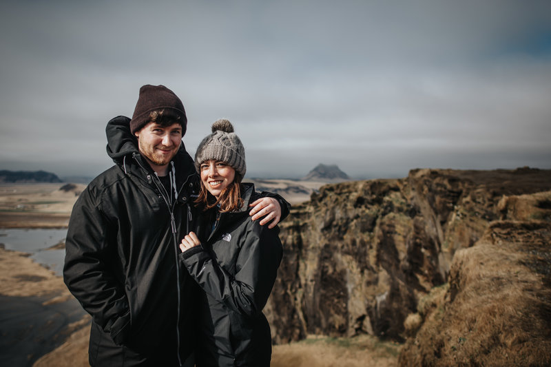 couple arms around each other in front of view in Iceland