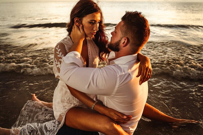 couple on beach in water romantic