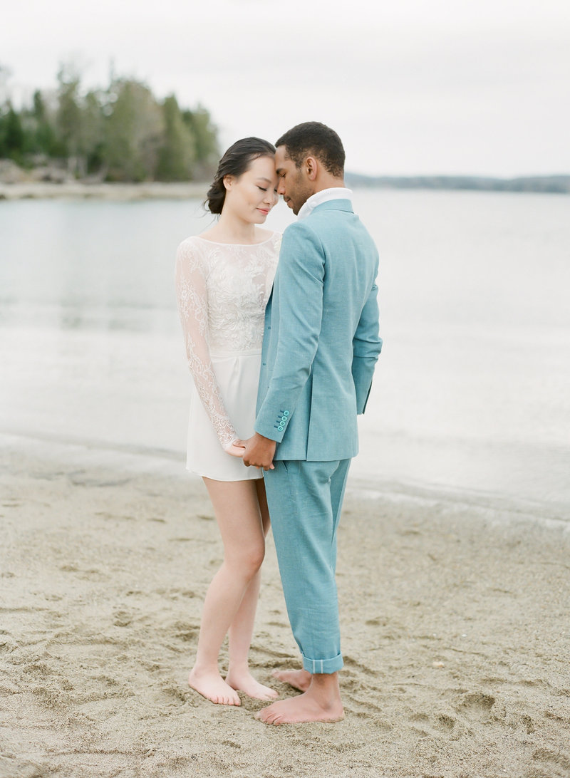 Bridal Couple on the beach in St Margaret's Bay Nova Scotia by Halifax Photographer Jacqueline Anne, captured on film