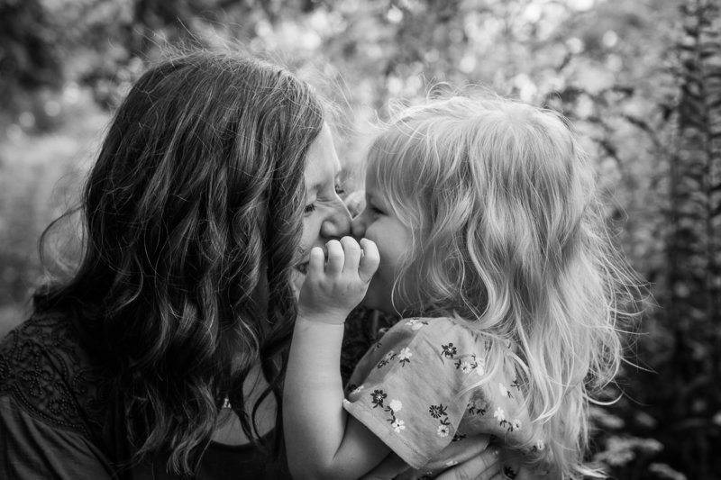 Scrunching noses mama daughter black and white