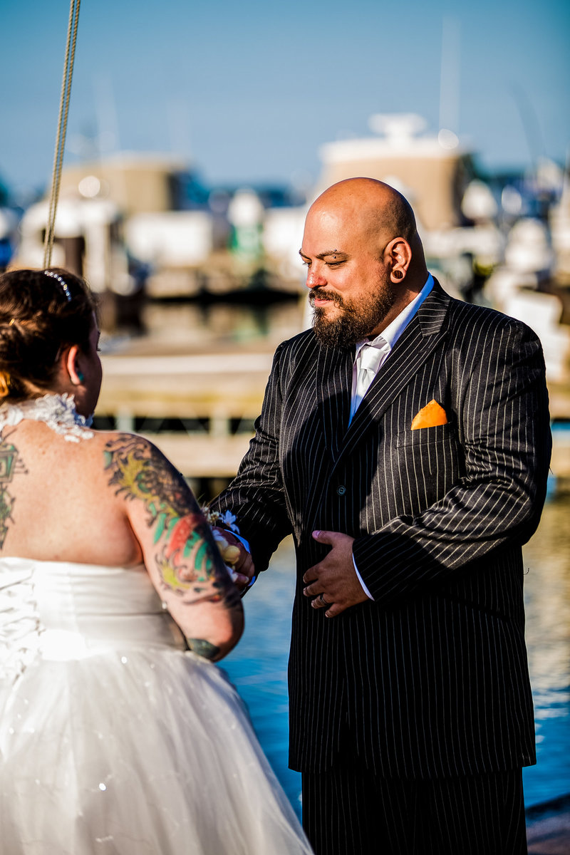 Groom looking lovingly at bride during an Erie Yacht Club wedding
