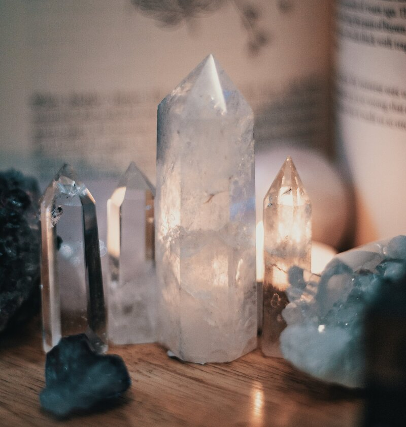 crystals-on-wooden-table-3610753