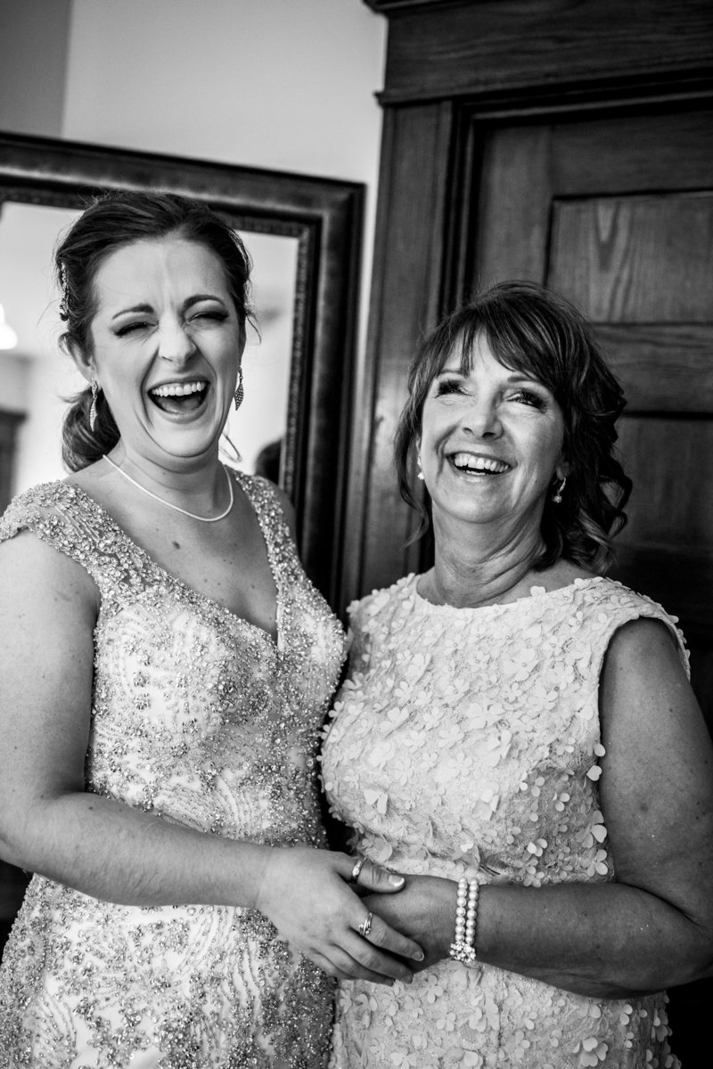 mom and bride sharing a laugh