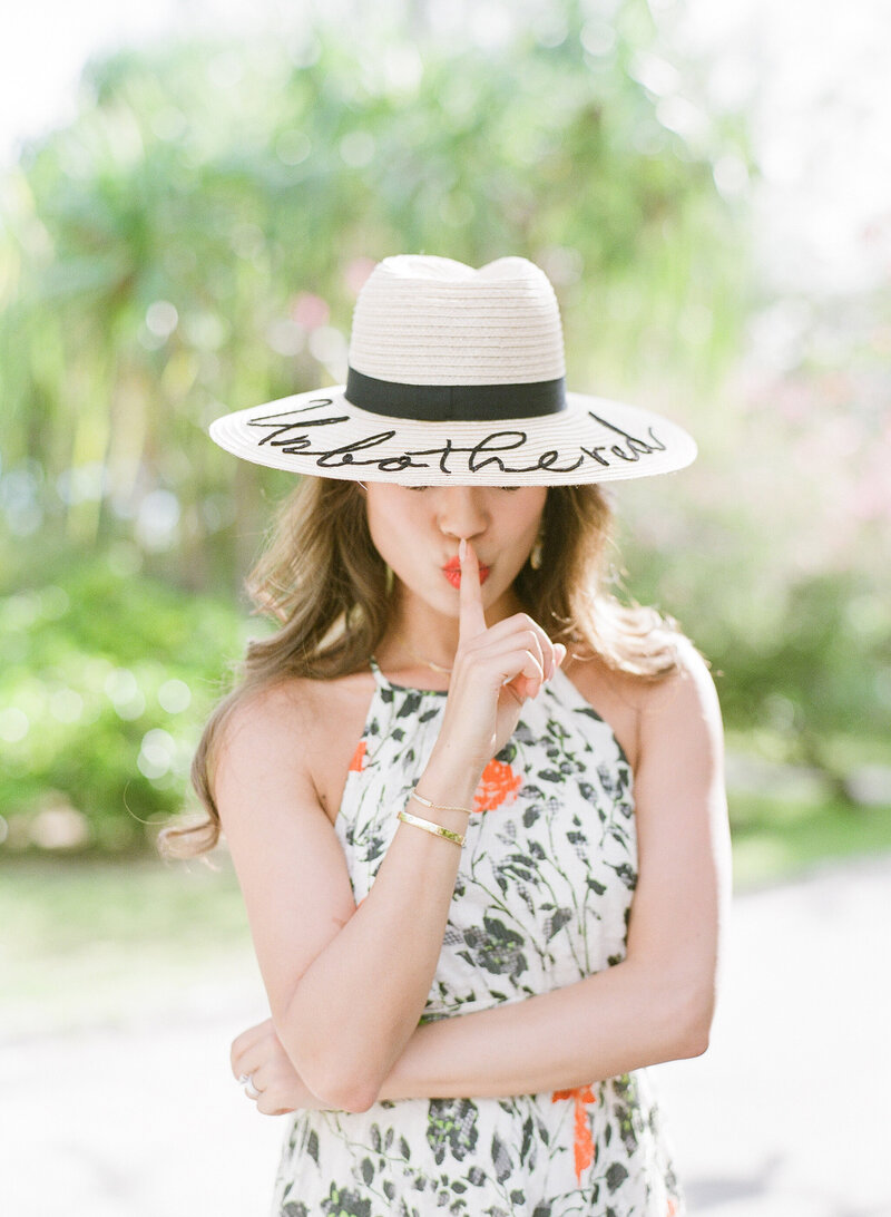 Artistic portrait woman with hat in the St Regis Bora Bora gardens