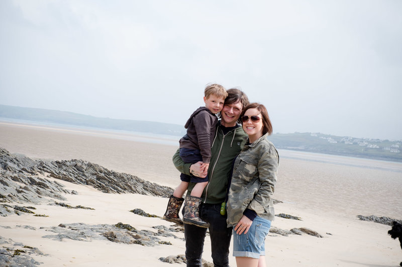 photo of charlie and her boys on the beach